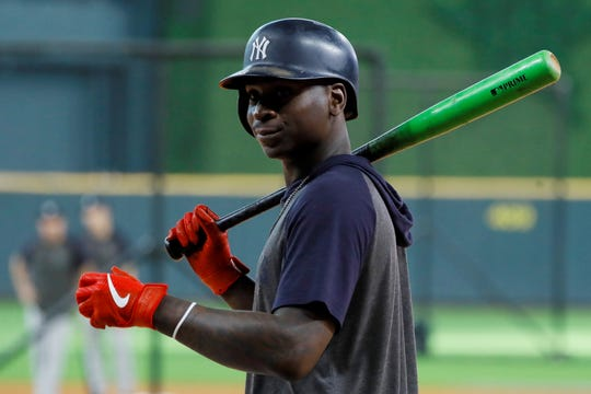 FILE - In this Saturday, Oct. 19, 2019, file photo, New York Yankees shortstop Didi Gregorius prepares to take batting practice before Game 6 of baseball's American League Championship Series against the Houston Astros in Houston. Gregorius is joining manager Joe Girardi in Philadelphia, agreeing with the Phillies on a $14 million, one-year contract, a person familiar with the deal told The Associated Press, late Tuesday, Dec. 10, 2019. (AP Photo/Matt Slocum, File)