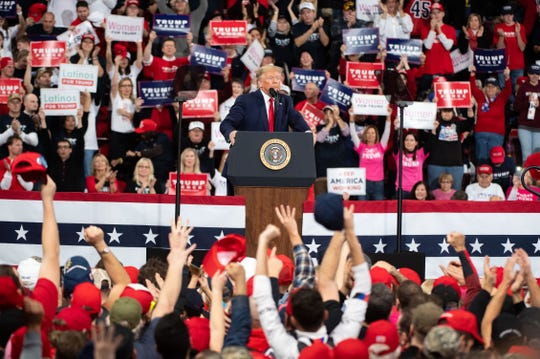 President Donald Trump takes in the applause during the President Donald Trump rally in Giant Center in Hershey, Pennsylvania, December 10, 2019.
