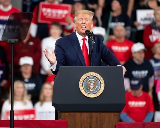 President Donald Trump tells the crowd to vote for him in the coming 2020 election during the President Donald Trump rally in Giant Center in Hershey, Pennsylvania, December 10, 2019.