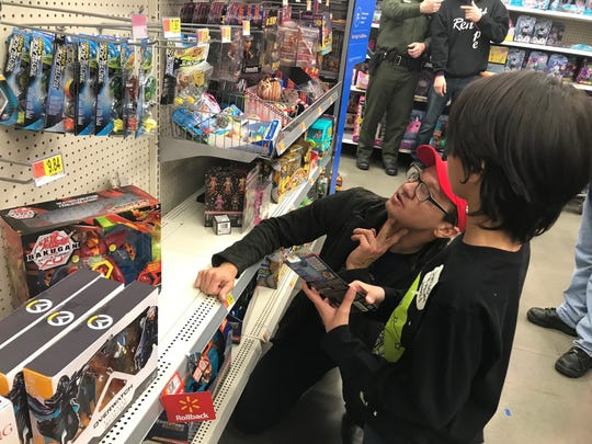 "Jeremy Renner and Sebastian Villaflores, 10, shop for toys for the ""Shop with the Sheriff"" event at the Walmart in South Reno on Dec. 10, 2019."