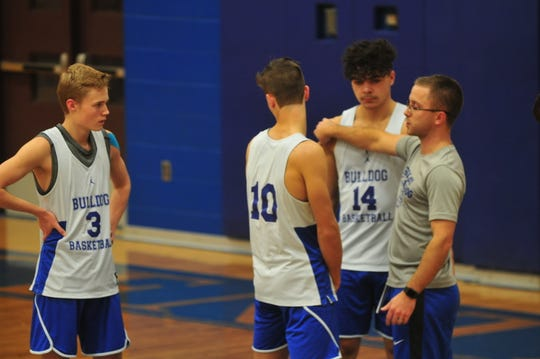 Centerville head coach Seve Beach gives direction to Austin Farlow (3), Kobe Brown (14) and the Bulldogs during a practice on Tuesday, Dec. 10, 2019.