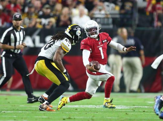 Arizona Cardinals quarterback Kyler Murray is pursued by Pittsburgh Steelers linebacker Bud Dupree.
