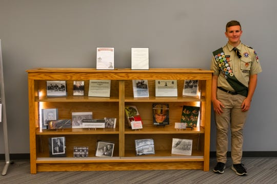 Tommy Gallatan, 18, of Webster and the oak display case he built for his Eagle Scout project to honor football and Vietnam war hero Don Holleder.
