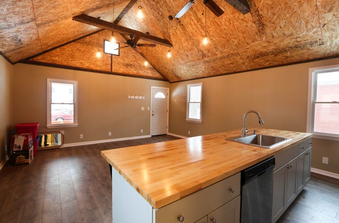The kitchen and  main living space  in this small house in the 19th Ward.