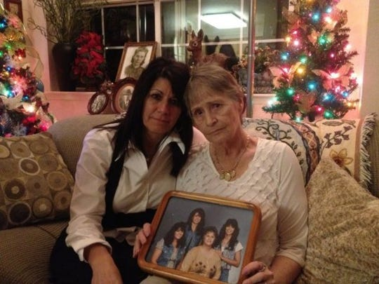 """Pam Orchard (left) and Rebecca Mendoza, the sister and mother of Angie Fullmer, in December 2012. At the time, Fullmer had been missing for 10 years from the Mount Shasta area. """"We love her and miss her,"""" Orchard said."""