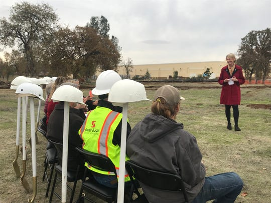 Shannon Phillips of the McConnell Foundation gestures toward other backers of the Center of Hope at its groundbreaking ceremony in east Redding in this December 10, 2019 picture.