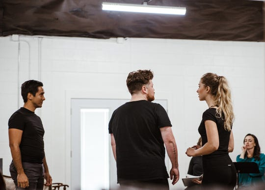 "Christophe Thazard, left, Hunter Odom and Sara Hauser rehearse a scene from ""Nora."" The adaptation of Henrik Ibsen's ""A Doll's House"" opens Friday at 1014 Locust St."