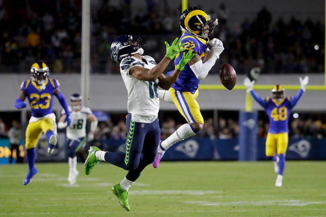 Los Angeles Rams cornerback Troy Hill breaks up a pass intended for Seattle Seahawks wide receiver Tyler Lockett during the first half of an NFL football game Sunday, Dec. 8, 2019, in Los Angeles.