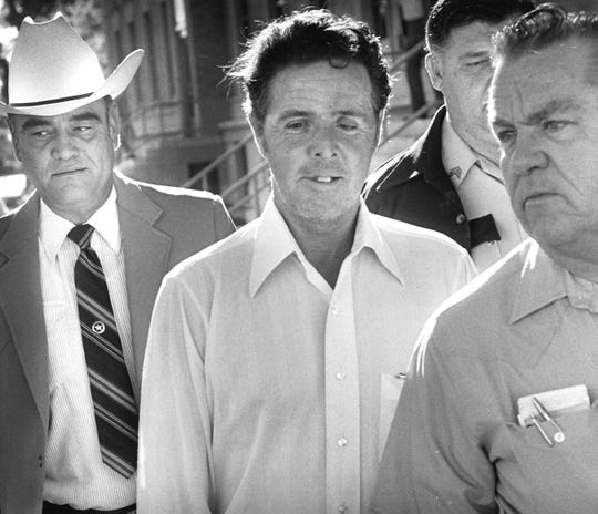 Henry Lee Lucas is escorted from the Tom Green County Courthouse after a jury sentenced him to death for the 1979 murder of an unidentified woman found near Georgetown in this archived photo from  June 1, 1984.