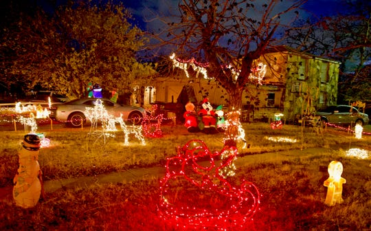 A home on Volney Street displays a wide variety of features including reindeer and Santa Claus arriving on the roof as seen in this Tuesday, Dec. 11, 2019 photo.