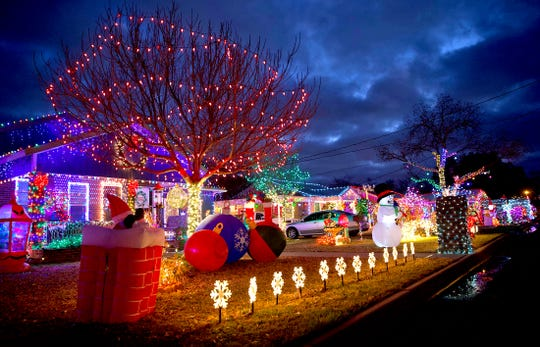 The Christmas light attraction at 223 E. 23rd Street in San Angelo actually features three adjacent homes all lit up into one large display as seen in this Tuesday, Dec. 11, 2019 photo.