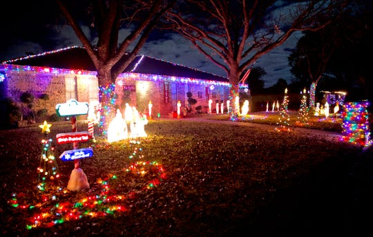 A home located at 3026 Rock Brook Dr. stands out for its use of illuminated figurines dotting the front yard as seen in this Tuesday, Dec. 11, 2019 photo.