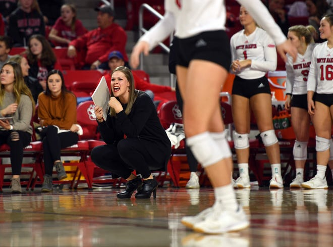 USD coach Leanne Williamson calls out to the players on the court in the quarterfinals of the National Invitational Volleyball Championship on Tuesday, Dec. 10, at the Sanford Coyote Sports Center in Vermillion.