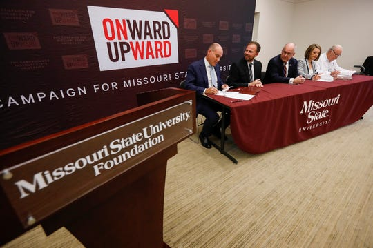 From left, Brent Dunn, John Jungmann, Clif Smart, Erin Danastasio, and Bill Darr sign a document giving $6.5 million from the Darr Family Foundation to build a new six-classroom agricultural magnet school near the MSU College of Agriculture.