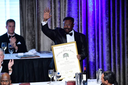 Former FAMU football head coach Joe Taylor waves to the crowd upon receiving his award for enshrinement in the College Football Hall of Fame on Tuesday, Dec. 10, 2019.