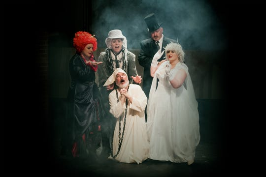 """Clockwise from bottom: Kevin Nickens as Scrooge, Melissa Findley as the Ghost of Christmas Present, Tom Sheehan as Jacob Marley, Ryan Burk as the Ghost of Christmas Yet to Come, Jessy Reaves as the Ghost of Christmas Past in Theatre Tallahassee's production of """"A Christmas Carol."""""""