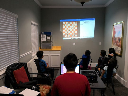 Ben Chen gives free chess lessons to students at W.T. Moore Elementary School. He'll compete in the U.S. Chess Federation-sanctioned National K-12 Grade Championships in Disney's Coronado Springs Resort Dec. 13-15, 2019.