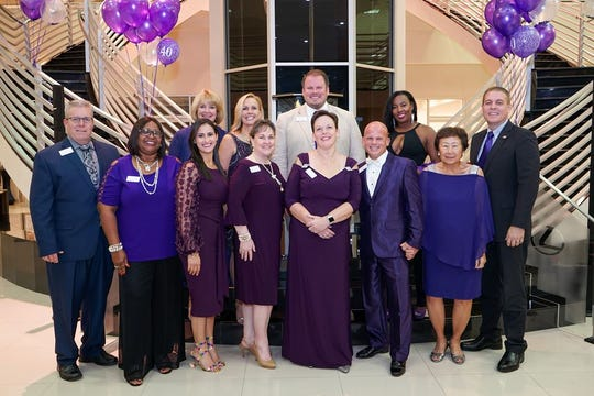 Capt. Adam Goodner, front row, from left, Charmaine Hickey, Emmelis Keaney, Linda Hengerer, Terri Hamrick, Dan Pimpo, Nancy Wong and Major Eric Flowers, with back row, Carol Myers, Joyce Page, Richard Boga and Natalie Desmangles at SafeSpace's 40th Birthday Bash at Treasure Coast Lexus in Fort Pierce.