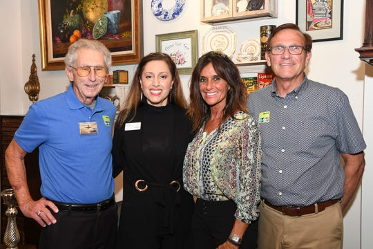 Dave Young, left, Lisa Young, Deena Rahill and President Ron Rose with the Jensen Beach Chamber of Commerce at the grand opening of O's Café @ The Elliott Museum on Hutchinson Island.