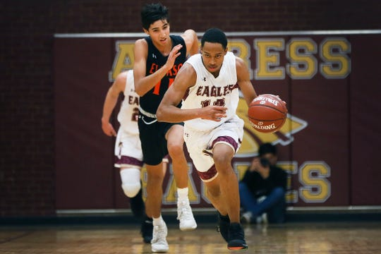 Andress' Devonte Owens goes against El Paso High during the game Tuesday, Dec. 10, in a District 1-5A showdown at Andress High School.