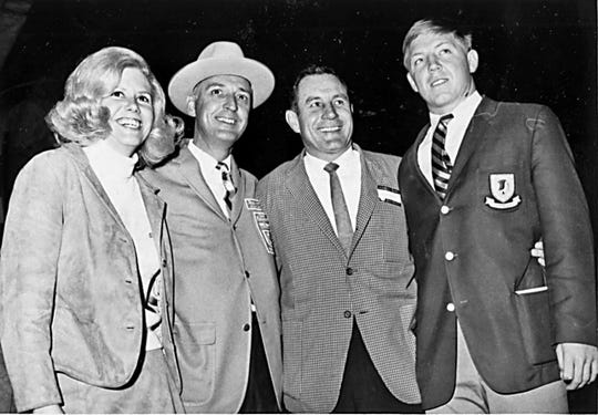 12/19/1966 - FLORIDA STATE REACHES THE PASS - Florida State's Seminoles flew to El Paso Sunday night for final preparations for their Sun Bowl Game against University of Wyoming. Left to right are Sun Queen-elect Susan McKee; Dr. Non Ewalt, Sun Carnival vice president and game chairman, Florida State football coach Bill Peterson and Seminole offensive center John Stephens.