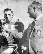 12/31/1967 SUN BOWL 1967 - RECEIVES MOST VALUABLE TROPHY - Billy Stevens, UTEP quarterback, receives the Dr. C.M. Hendricks' Award from sun Bowl game selection committee chairman Colbert Coldwell.