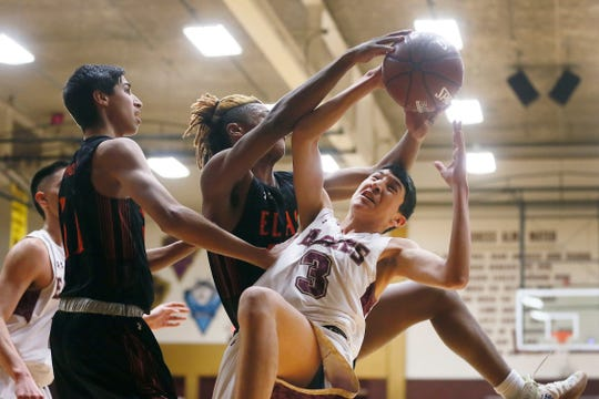 Andress' Christian Villegas during the game against El Paso High Tuesday, Dec. 10, in a District 1-5A showdown at Andress High School.