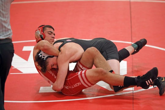 Arlington's Dennis Robin defeats North Rockland's Dionezus Collado during the 152 pound wrestling match at North Rockland High School in Thiells Dec. 10, 2019.