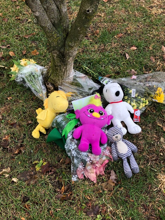 Flowers and stuffed animals are left outside the Liu family house along Romer Street in Pleasantville on Dec. 10, 2019.