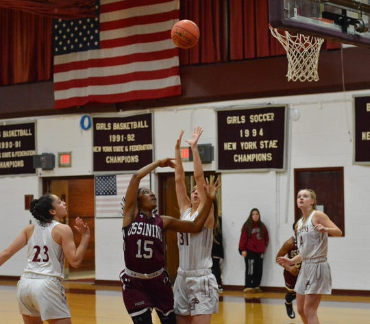 Ossining forward Adrianna McFadden flips a shot over Albertus Magnus forward Emma Parahus on Tuesday. McFadden scored a game-high 31 points in the loss on Dec. 10, 2019 at Albertus Magnus High School