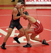 North Rockland's Joe Henion and Arlington's Tim Boya wrestle in the 138 pound match at North Rockland High School in Thiells Dec. 10, 2019.