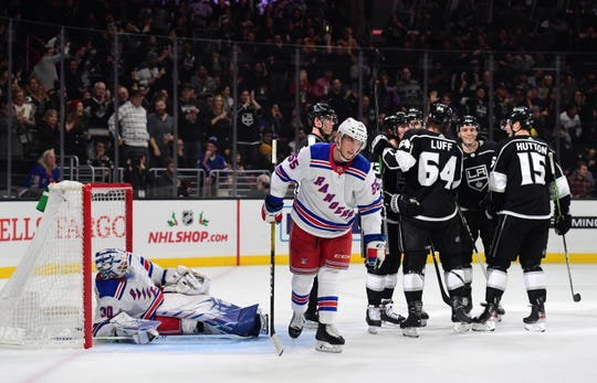 Dec 10, 2019; Los Angeles, CA, USA; New York Rangers goaltender Henrik Lundqvist (30) and defenseman Ryan Lindgren (55) react after a goal by Los Angeles Kings right wing Tyler Toffoli (73)  in the second period at Staples Center.