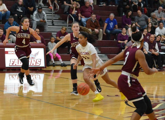 Albertus Magnus point guard Tanasha Mills gets around the defense and looks for options in the lane during the second half of a season-opening win against Ossining on Dec. 10, 2019 at Albertus Magnus High School.