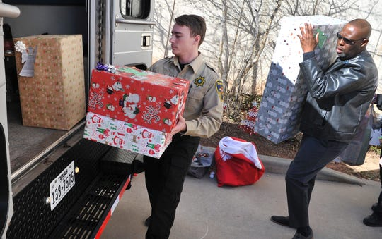 Wichita County deputies and courthouse employees lined up to help deliver Christmas gifts for the annual courthouse Angel Tree, Wednesday afternoon.