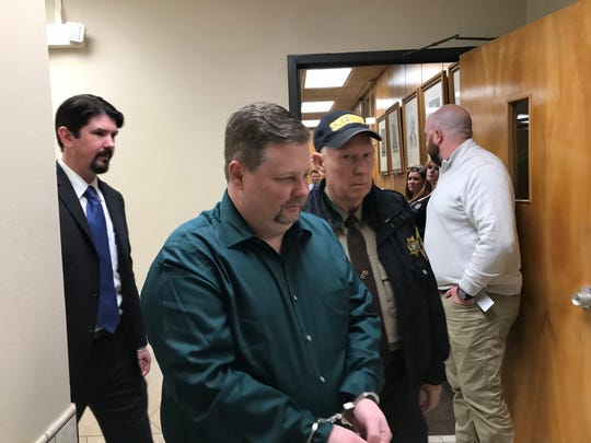 Jason Wayne Carlile was led away in handcuffs after he was found guilty of eight counts of child sex crimes Wednesday in 78th District Court.