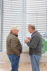 Wisconsin Farm Bureau President Jim Holte, right, spends time talking with American Farm Bureau Federation President Zippy Duvall during a farm tour in Manitowoc County in October 2017.