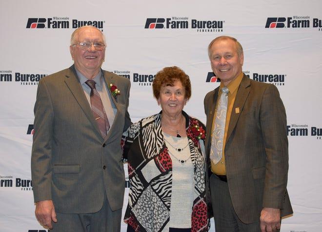 Bob and Karen Schwandt are joined by WFBF President Jim Holte, right. The Dodge Co. couple received Farm Bureau's highest award of Distinguised Service.