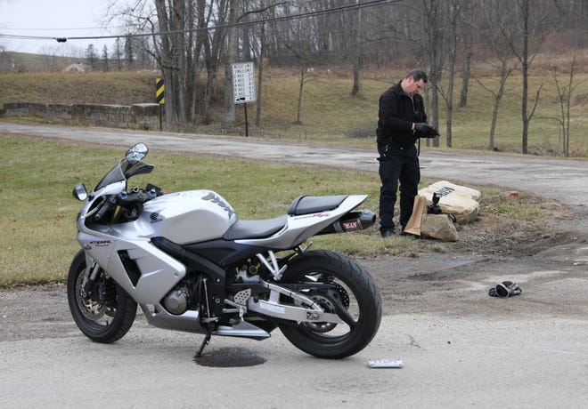 Detective Gary Moore of the Zanesville Police Department investigates the scene where a motorcyclist crashed after a lengthy and at times high-speed chase across two counties Wednesday. The wreck happened at Gratiot after starting in Cambridge.