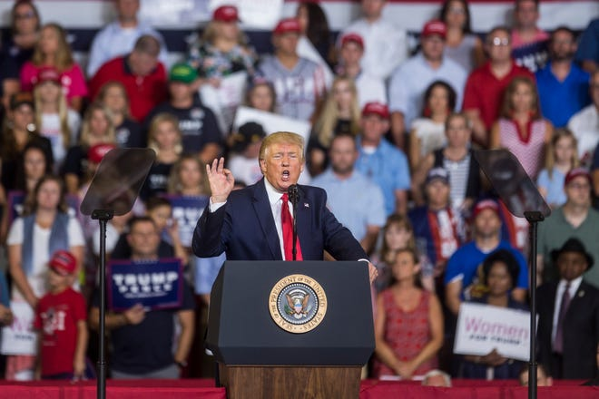 """President Donald Trump speaks during a Keep America Great rally on July 17, 2019, in Greenville, North Carolina. The rally made headlines as the president's supporters chanted """"send her back"""" in reference to Rep. Ilhan Omar, D-MN, who is a U.S. citizen born in Somalia. In days prior, Trump had attacked a group of four Democratic congresswomen, tweeting that they should """"go back and help fix"""" the countries they came from."""