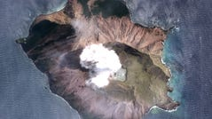 A handout satellite photo made available by MAXAR Technologies shows the White Island (Whakaari) volcano one day after erupting, in New Zealand, Dec. 11, 2019.