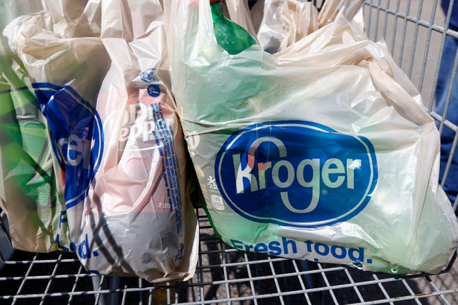 In this June 15, 2017, file photo, bagged purchases from the Kroger grocery store in Flowood, Miss., sit inside a shopping cart.
