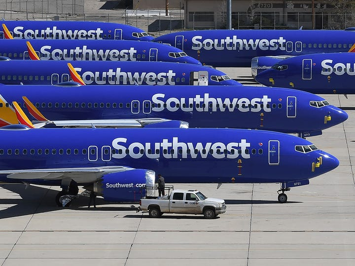 Southwest Airlines Boeing 737 MAX aircraft are parked on the tarmac after being grounded, at the Southern California Logistics Airport in Victorville, California.