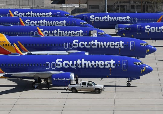 Southwest Airlines Boeing 737 MAX aircraft are parked on the tarmac after being grounded at the Southern California Logistics Airport in Victorville.