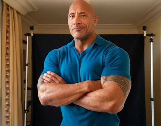"""Dwayne Johnson has been a character in the wrestling ring and in many movies since he made the jump from grappler to Hollywood superstar. Now his formative years are the subject of a new NBC comedy, """"Young Rock."""""""