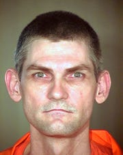 This undated booking file photo provided by the Arizona Department of Corrections shows James Erin McKinney.