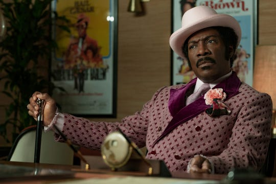 "Eddie Murphy plays Rudy Ray Moore, a singer and comedian who wills himself to become a comic action star in 1970s blaxploitation movies in ""Dolemite Is My Name."""