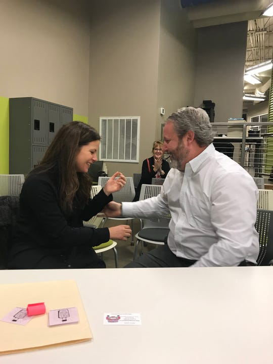 Whitney Farmer Black reacts to winning the LEAP Anderson pitch night with her husband, Talbert Wednesday, Dec. 11. Black's business is a make-and-take art class space near downtown Anderson.
