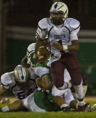 Toms River South's Tymere Berry picks up yardage against Brick in a 2013 game.