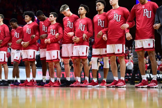 Rutgers basketball players wearing throwback uniforms against Wisconsin