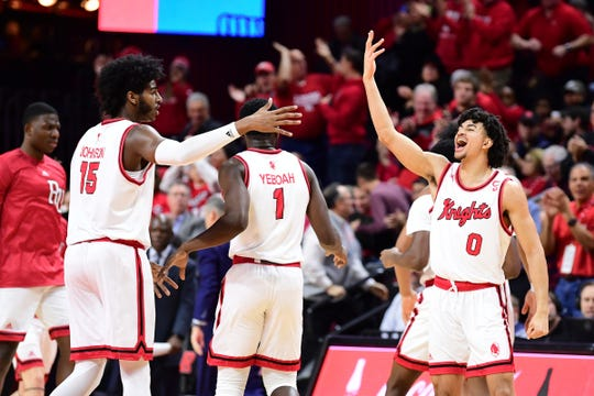 Left to right: Rutgers players Myles Johnson, Akwasi Yeboah and Geo Baker celebrate against Wisconsin.